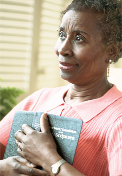 A woman searching for happiness by reading the Bible