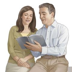 En mand og hustru læser i Bibelen sammen