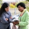 One of Jehovah's Witnesses shares a Bible scripture with a woman at home