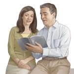 Муж и жена заједно читају Библију