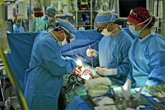 Doctors performing bloodless surgery