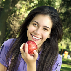 A girl eating an apple
