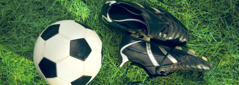 A soccer ball and a pair of soccer shoes
