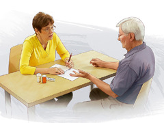 A wife helps her husband make a list of his symptoms and medications