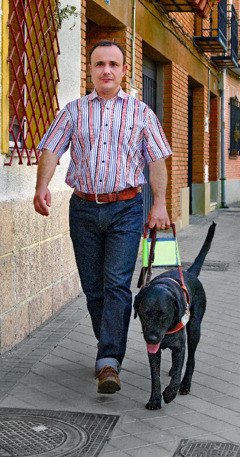 Marco Antonio and his guide dog, Dante