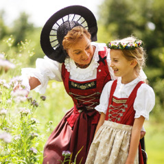 A woman and a little girl in Liechtenstein dressed in colorful ethnic clothing