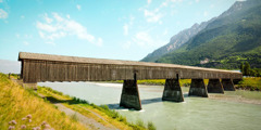 A covered bridge over a river in Liechtenstein