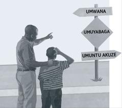 Umugabo n'umuhungu wiwe bariko bitegereza icapa cerekana ko ubuyabaga ari ikiringo gituma umuntu ava mu bwana akaba uwukuze