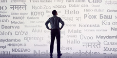A man looks at words in many different languages