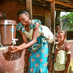 A woman washes her hands