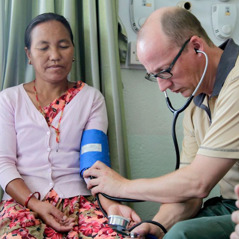 One of Jehovah's Witnesses from a medical team in Europe checks a Nepal earthquake victim's blood pressure