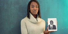 Dami holds a picture of her father