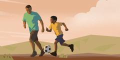 אב משחק כדורגל עם בנו