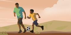 پدری با پسرش فوتبال بازی میکند