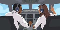 A couple works together as pilot and copilot in the cockpit