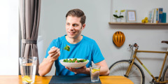 A man eats a salad