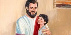 Jesus håller om ett litet barn.