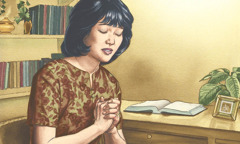 A woman dedicates her life to Jehovah in prayer