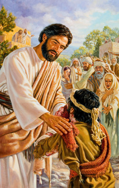 Jesus Christ compassionately touches a leper and heals him