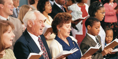 Happy worshippers of Jehovah God singing praises to him at a Christian meeting