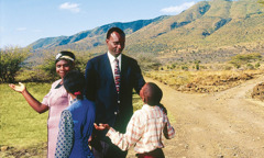 A family stands at a crossroad