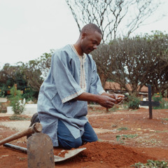 A man at a grave site