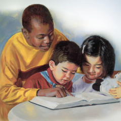 An older boy reads the Bible to two small children