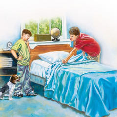 An older boy helps his younger brother make his bed