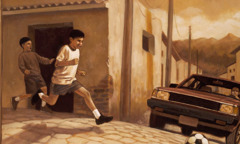 Two boys play in the street as a car approaches