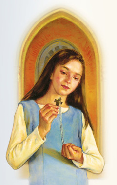 A girl holds rosary beads