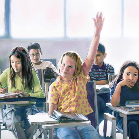 Una niña levanta la mano en clase