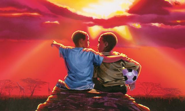 Dos niños miran una puesta de sol