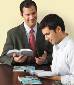 Two men studying the Bible using the Bible Teach book