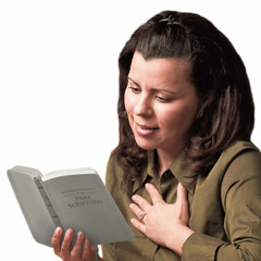 A grieving woman finding comfort from reading the Bible