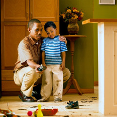 A father lovingly corrects his son who has brought mud into the house
