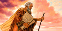 Moses holds the two stone tablets containing the Ten Commandments