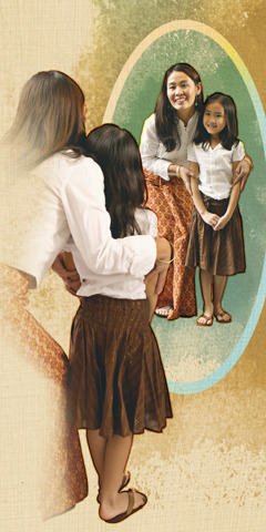 Vasana and her little girl look in a mirror