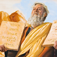 Moses holds the stone tablets containing the Ten Commandments