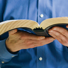 A man holds the Holy Scriptures