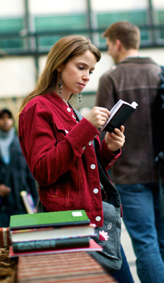 A young woman reads the Bible