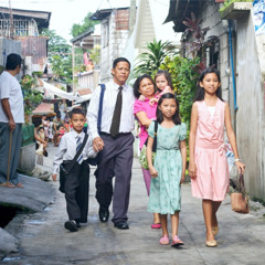 A family in the Philippines walking to a meeting