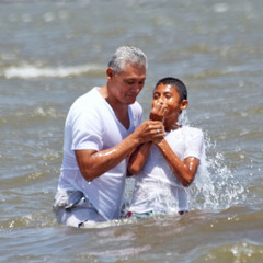 A young man being baptized in Nicaragua