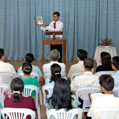 A ministerial servant giving a spiritual talk