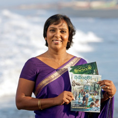 A woman in Sri Lanka holding magazines translated by Jehovah's Witnesses