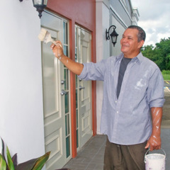 One of Jehovah's Witnesses painting a Kingdom Hall in Puerto Rico