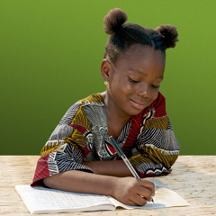 A young girl writing her name in her song book