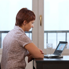 A woman watching a sign language video online