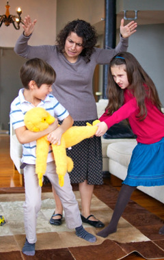 A mother loses self-control with her children as they fight over a toy