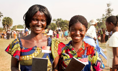 Two Christian sisters at a convention of Jehovah's Witnesses in the Democratic Republic of Congo