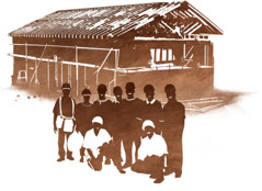 Volunteers in front of a Kingdom Hall under construction